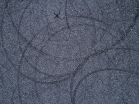 The track of the tire drawn with a circle. Perspective from drone. Shadow of the drone.