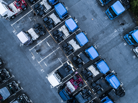 Lots of parked trucks. Aerial shooting from directly above.