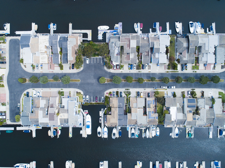 Aerial view of a resort town in the waterside. House with private boat. Zdjęcie Seryjne