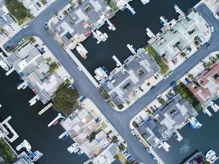 Aerial shooting of a luxury resort town on the waterside. A villa with a private boat. Aerial shooting of a luxury resort town on the waterside. A villa with a private boat.