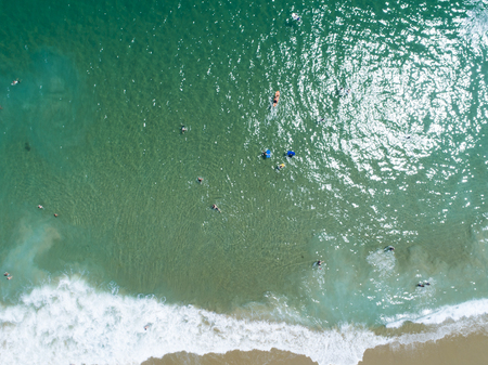 Aerial shooting of beautiful seas and sandy beaches. People who enjoy vacation. Stock Photo