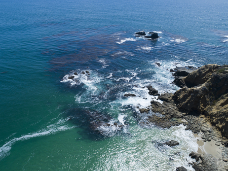 Aerial photograph of beautiful sea and rocky area and wave.