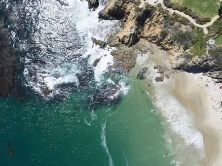 Aerial photograph of resort beach, sandy beach, rocky area. Zdjęcie Seryjne