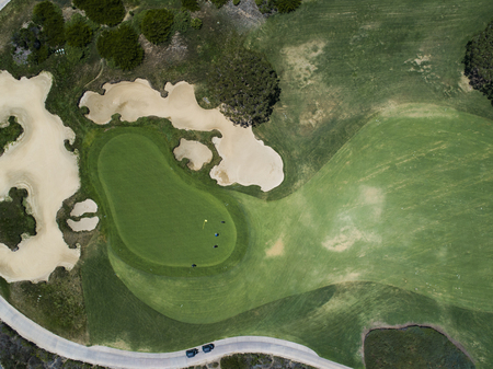 Aerial photograph of a golf course in a resort area.