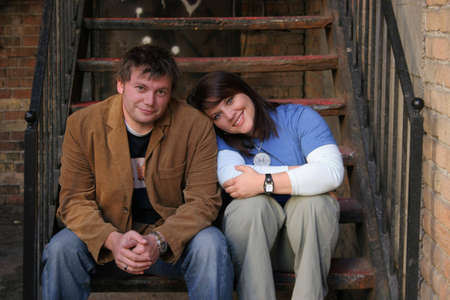 love at first sight: A young couple sitting on stairs in an alley. Stock Photo