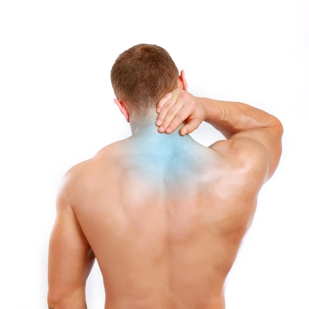 Muscular man with back neck ache  photo