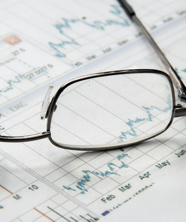 Eyeglasses lying down on a business document photo