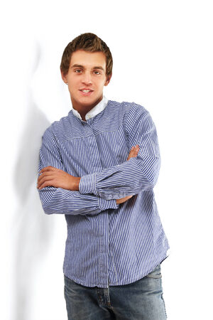 unemotional: Young college guy standing near wall, isolated on white Stock Photo