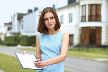 female architect: Female architect standing with folder