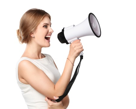 Business woman with megaphone yelling and screaming isolated on white background Standard-Bild