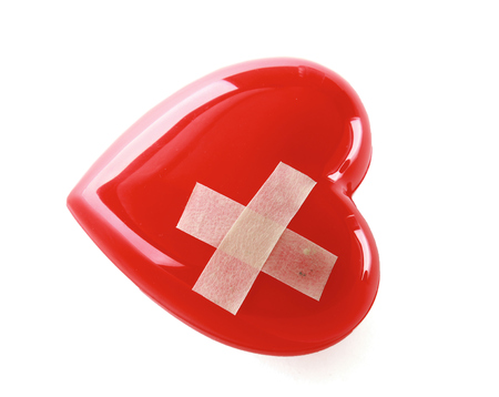 mended: Heart With Plaster, Isolated On White Background Stock Photo