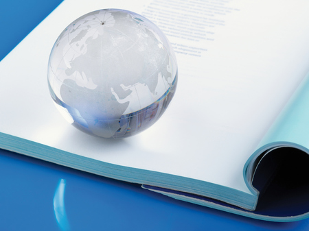 lying: glass globe lying on book.