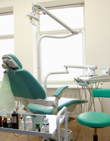 modern Dentist's chair in a medical room photo