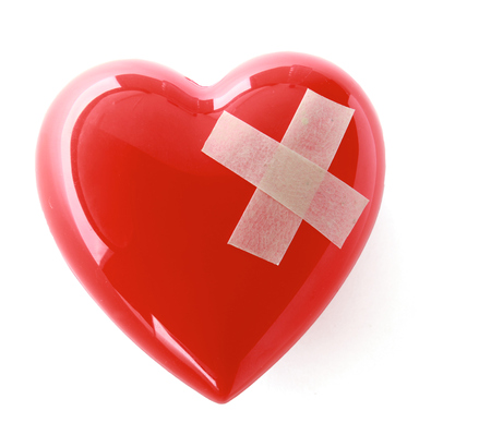 mended: A red heart isolated on white background