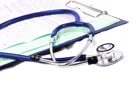 Stethoscope on medical billing statement on table, all text is anonymous photo