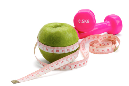 weight scale: An apple, a measuring tape and dumbbell.