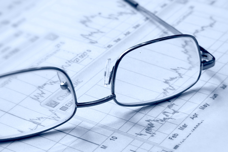 Eyeglasses laying down on a business document photo