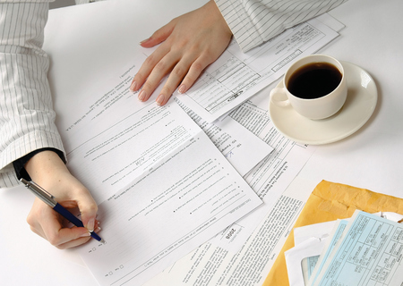 Business woman working with tax documents Stock Photo