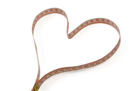 A measuring tape shaping a heart. photo