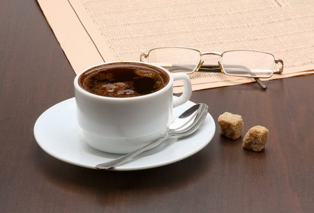 Cup of coffee and newspaper. photo