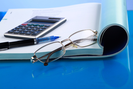 Business concept with notebook and calculator. photo