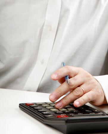 young man calculating bills at home photo