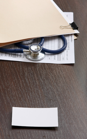 Medical objects on a wooden table photo
