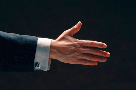 sideview: A businessman's handshake, side-view