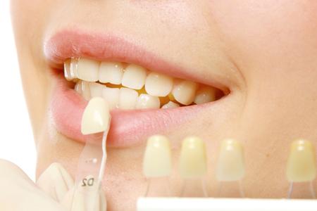 Examining patient's teeth Archivio Fotografico