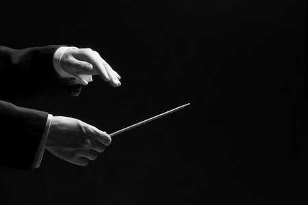 Hands of a conductor isolated on black background, black and white Reklamní fotografie - 35309104