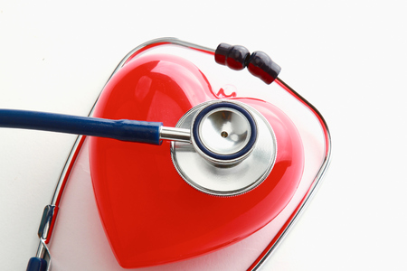 A heart with a stethoscope, isolated on white background photo