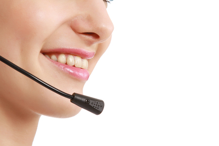 Closeup of a smiling customer service girl photo