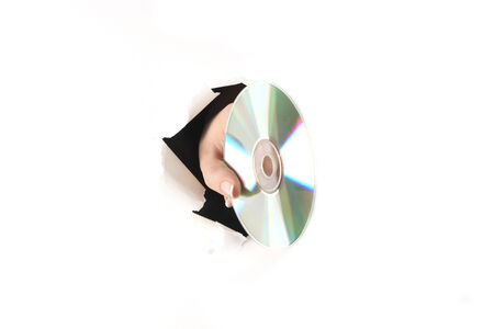 A hand with a laser disk tearing a white paper photo