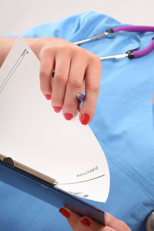 Close-up of a clipboard in the hands of a nurse photo