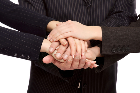 accord: Hands of businesspeople together, closeup