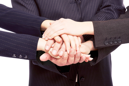Hands of businesspeople together, closeup