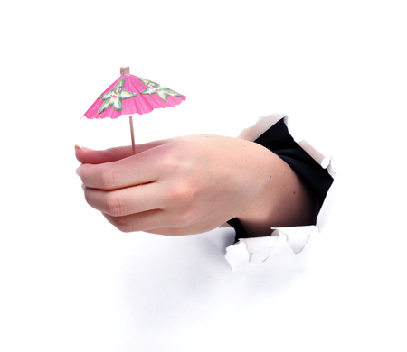 cocktail umbrella: Cocktail Umbrella with human hand isolated against white