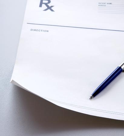 rx: A blue pen on a rx prescription. Stock Photo