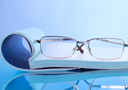 published: Open journals with glasses in front
