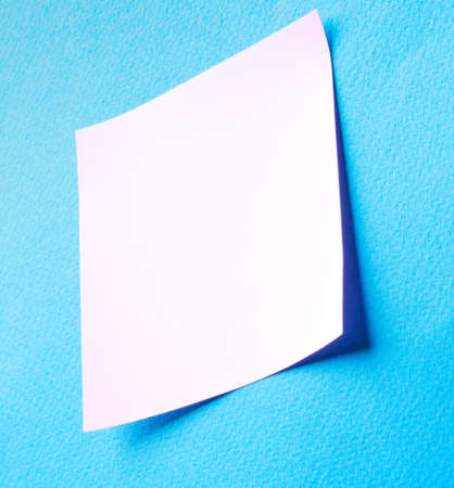 paper note: Pink paper note on blue