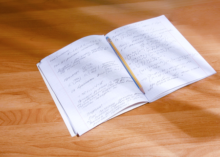 err: Notebook with pencil Stock Photo