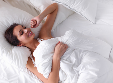 bed sheets: Pretty woman lying  in bed