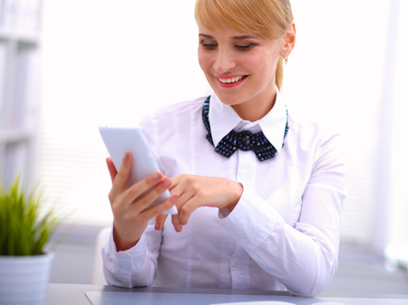 phonecall: Woman in office using mobile phone
