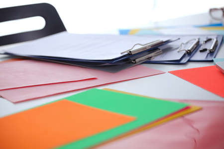 worktable: Worktable covered with documents Stock Photo