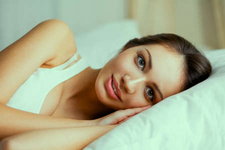 woman at night: Pretty woman lying  in bed