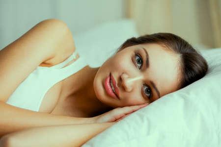 sleeping woman: Pretty woman lying  in bed