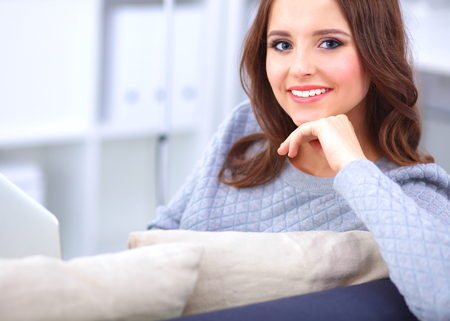 pretty: Happy pretty woman using laptop sitting on  sofa Stock Photo