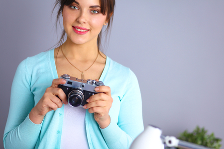 proffessional: Woman is a proffessional photographer with camera