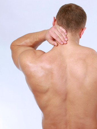 back ache: Muscular man with back neck ache isolated on white background