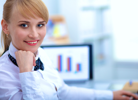 downloaded: Female photographer sitting on the desk with laptop Stock Photo